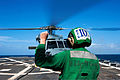 U.S. Navy Aviation Machinist's Mate 3rd Class Sarah Werner signals to the pilots of an SH-60 Seahawk helicopter during flight operations aboard the guided missile destroyer USS Gravely (DDG 107) in the 130327-N-ZL691-082.jpg