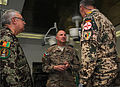 U.S. Navy Capt. Barth Merrill, center, the commander of the Kandahar Regional Medical Hospital, welcomes German army Brig. Gen. Juergen Brandenstein, right, the command surgeon of the International Security 130819-A-VM825-008.jpg