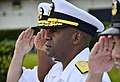 U.S. Navy Rear Adm. Frank Ponds, center, the commander of Navy Region Hawaii and Naval Surface Group Middle Pacific, salutes the U.S. flag March 19, 2013, at Joint Base Pearl Harbor-Hickam, Hawaii 130319-N-RI884-048.jpg