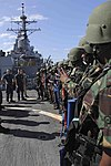 U.S. Sailors assigned to the guided missile destroyer USS Gonzalez (DDG 66) prepare to embark with Tanzanian sailors before starting a non-compliant boarding scenario aboard the Gonzalez June 6, 2013, in 130606-N-VD227-408.jpg