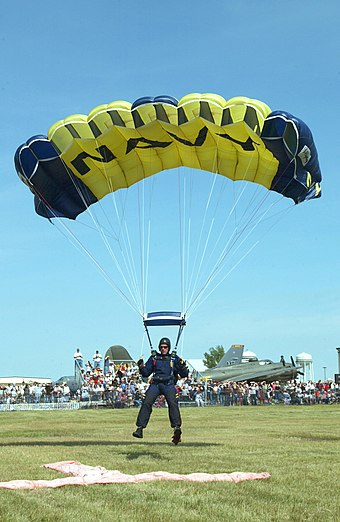 "A United States Navy Parachute Team ""Leap Frogs"" jumper landing a ""square"" ram-air parachute. Ram air square.jpg"