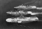 USS Vega (AF-59) replenishes USS Tripoli (LPH-10) and USS Thomaston (LSD-28) off Vietnam, circa in 1969.jpg
