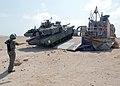 US Navy 021109-N-4374S-012 An Land Craft Air Cushion (LCAC) assigned to Assault Craft Unit Four (ACU 4) offloads an M1-A1 Abrams tank.jpg