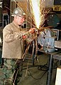 US Navy 021109-N-5152S-001 A Naval Reservist works on a frame in the welding shop.jpg
