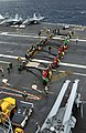 US Navy 021206-N-1328C-506 Flight deck personnel practice rigging the crash barricade on the ship's flight deck.jpg