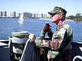 US Navy 030328-N-3211R-003 Craftmaster, Signalman 1st Class Tom Merryman from Long Island, N.Y., gives orders to the helm and leehelm via a soundtube.jpg