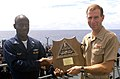 US Navy 030426-N-8935H-003 Rear Adm. Frederic Ruehe, Commander, Amphibious Group (COMPHIBGRU) One presents the COMPHIBGRU One Battle Efficiency Award for 2002 to USS Blue Ridge (LCC 19).jpg