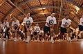 US Navy 030510-N-5862D-323 Recruits warm up before participating in the Captain's Cup sports competition.jpg