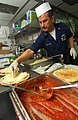 US Navy 030913-N-5471P-002 petty officers make pizzas for the crew for.jpg