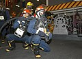 US Navy 040625-N-5952R-027 Hull Maintenance Technician Fireman Jeremy Critchlow, from Huntsville, Texas, and Boatswain's Mate 3rd Class Russell Crain, from Fort Worth, Texas, assigned to USS Enterprise (CVN 65), prepare to figh.jpg
