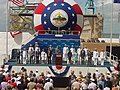 US Navy 040731-N-5258M-005 The official party for the christening of PCU Texas (SSN 775) stand in front of the audience at Northrop Grumman Newport News Shipyard.jpg