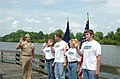 US Navy 040910-N-0000X-002 Naval Recruiting District Montgomery, Commanding Officer Cdr. Greg LaFave swears in the McIntyre family by the Coosa River, Gadsden, Ala.jpg