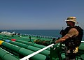 US Navy 040927-N-7034S-004 A Sailor assigned to the Visit, Board, Search and Seizure (VBSS) team aboard the guided missile cruiser USS Mobile Bay (CG 53) stands watch aboard an oil tanker.jpg