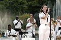 US Navy 050309-N-7923C-668 Musician 3rd Class Amanda Leslie of the U.S. Seventh Fleet Band sings during a public concert at Sentosa Island in Singapore.jpg