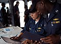US Navy 050316-N-7526R-061 Lt. Robert Moore of Chicago, Ill., right, and Lt.j.g. Katie Frank of St. Marys, Ohio, verify charts and navigational information on the bridge of USS Blue Ridge (LCC-19).jpg