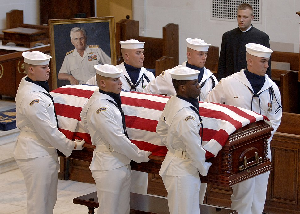US Navy 050723-N-5390M-002 The casket of Medal of Honor recipient, retired Vice Adm. James B. Stockdale, is carried from the U.S. Naval Academy Chapel by the ceremonial guard