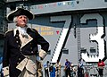US Navy 050926-N-1045B-071 A General George Washington impersonator, William A. Sommersfield, poses in front of the ship's band on the flight deck of the Nimitz-class aircraft carrier USS George Washington (CVN 73).jpg