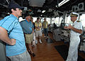 US Navy 060209-N-4965F-002 USS Port Royal (CG 73), Commanding Officer, Capt. David F. Matawitz, explains bridge operations to National Football League All-Stars.jpg
