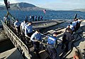 US Navy 060216-N-0780F-001 Crew members remove a shore power cable from the Los Angeles-class fast attack submarine USS Annapolis (SSN 760) in preparations to depart the pier following a routine port visit.jpg