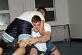 US Navy 061116-N-2789G-022 Culinary Specialist 3rd Class David Sena (left), assigned to USS Abraham Lincoln (CVN 72), wrestles.jpg