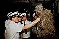 US Navy 061116-N-4124C-082 Vice Adm. Gu Wengen, Commander of the People's Liberation Army (Navy) (PLA(N)) South Sea Fleet, and members of his staff examine the camouflage dressing of a Marine with the 31st Marine Expediti.jpg