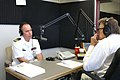 US Navy 070319-N-5324D-002 Cmdr. Paul Spear, commanding officer of USS Tucson (SSN 770), conducts an interview with John T. Scott at the KJLL-AM studios.jpg