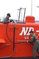 US Navy 070404-A-1595E-009 Chief Electrician's Mate Zach Montello, left, and Chief Electrician's Mate Stephen Brooke rig shore cables to NR-1 upon its return to Naval Submarine Base New London.jpg