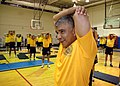 US Navy 070627-N-1328C-033 Master Chief Petty Officer of the Navy (MCPON) Joe R. Campa Jr., and naval personnel attending MCPON's Leadership Mess Meeting, stretches prior to a morning work out.jpg