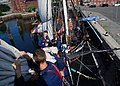 US Navy 070801-N-2385B-002 Working on USS Constitution's bowsprit, Sailors practice setting and furling the flying jib.jpg