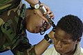 US Navy 070809-N-9195K-050 Lt. Tracy Branch checks the ear of a local patient during a medical screening at Bunabun Health Center in support of Pacific Partnership.jpg
