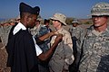US Navy 071113-N-3931M-030 An instructor from the French military pins a survival badge on U.S. Navy Hospital Corpsman 3rd Class Gwendolyn Collver, assigned to Combined Joint Task Force-Horn of Africa, upon completion of a dese.jpg