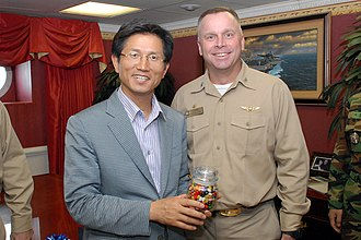 Kim Moon-soo (politician) - Image: US Navy 080713 N 1635S 003 Capt. Kenneth J. Norton, commanding officer of the Nimitz class aircraft carrier USS Ronald Reagan (CVN 76), presents a gift of jellybeans to Governor Moon Soo Kim