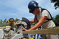 US Navy 080831-N-3595W-067 Air Force Staff Sgt. Alexander Oliver helps to rebuild a school house.jpg