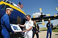 US Navy 090530-N-1928O-163 Vice Adm. Dirk J. Debbink, Chief of the Navy Reserve, receives a gift of appreciation from Marine Corps Maj. Drew Hess, and crewmembers of the Blue Angels C-130 Hercules.jpg