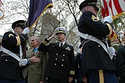US Navy 091111-N-6525D-246 Medal of Honor recipient Paul W. Bucha and Cmdr. Curt Jones render honors to the colors during the opening ceremony of the 90th New York City Veterans Day Parade