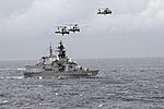 US Navy 091117-N-3830J-643 Helicopters fly above the Japan Maritime Self-Defense Force destroyers JDS Hiei (DDH 142) and JDS Kongo (DDG 173) as they maneuver into formation during Annual Exercise (ANNUALEX 21G).jpg
