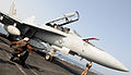 US Navy 100329-N-4236E-304 A Sailor signals the pilot of an F-A-18F Super Hornet assigned to the Jolly Rogers of Strike Fighter Squadron (VFA) 103.jpg