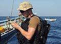 US Navy 100513-N-1082Z-020 Electronics Technician 2nd Class Benjamin E. O'Quinn takes notes while conducting maritime security operations.jpg
