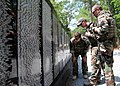 US Navy 100524-N-4205W-002 Special warfare combatant-craft crewmen read names on the Vietnam Traveling Memorial Wall during the annual Trail of Honor.jpg