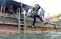 US Navy 100525-N-0413B-012 Brick Bradford, a retired Master Diver assigned to Joint POW-MIA Personnel Accounting Command (JPAC), jumps off a barge for a dive.jpg