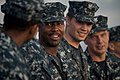 US Navy 100809-N-5319A-018 Seaman Jan Lane, center, stands in ranks during a reenlistment ceremony on the foc'sle of the amphibious transport dock ship USS New Orleans (LPD 18) as the ship participates in Southern Partnership S.jpg
