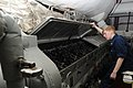 US Navy 100831-N-7191M-026 Engineman 2nd Class Brittany Davidson checks the fuel rack cylinders for adequate lubrication in the forward emergency diesel generator aboard USS George Washington (CVN 73).jpg