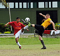 US Navy 110605-N-EP471-142 Hospital Corpsman 2nd Class Brett Myers, from Danville, Va., beats an opposing player to the ball in an exhibition socce.jpg