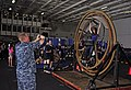US Navy 110827-N-SF704-093 Senior Chief Hospital Corpsman Paul Christensen photographs his daughter on a human gyroscope during a friends and famil.jpg