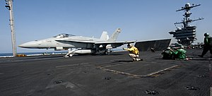 US Navy 120104-N-OY799-100 An F-A-18C Hornet from the Golden Dragons of Strike Fighter Squadron (VFA) 192 launches from the Nimitz-class aircraft c.jpg