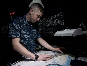US Navy 120111-N-TZ605-140 Air-Traffic Controller Airman Michael Reynolds, assigned to the operations department aboard the Nimitz-class aircraft.jpg