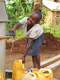 Ugandan girl at well.JPG