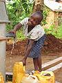 Ugandan girl at well.JPG