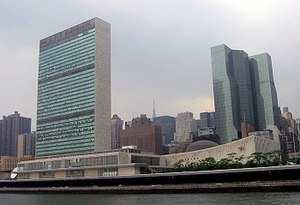 Robert Moses - The headquarters of the United Nations in New York City, viewed from the East River. The Secretariat Building is on the left and the General Assembly building is the low structure to the right of the tower. This set of buildings straddles the FDR Drive, another of Moses's creations.