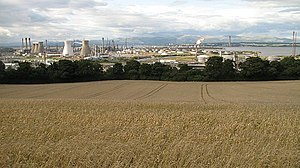 Inveravon - Wheat above Inveravon, with Grangemouth Oil Refinery